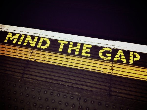 'Mind the gap' stencil at the edge of a platform